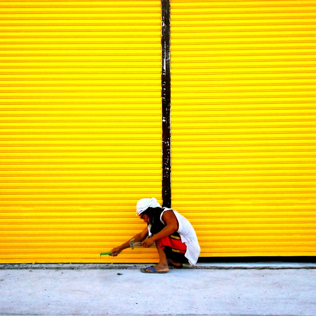 """male worker and a yellow wall"" stock image"