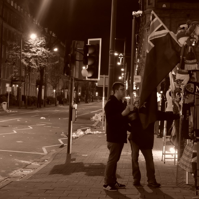 """Street photography: Flags, After the match"" stock image"