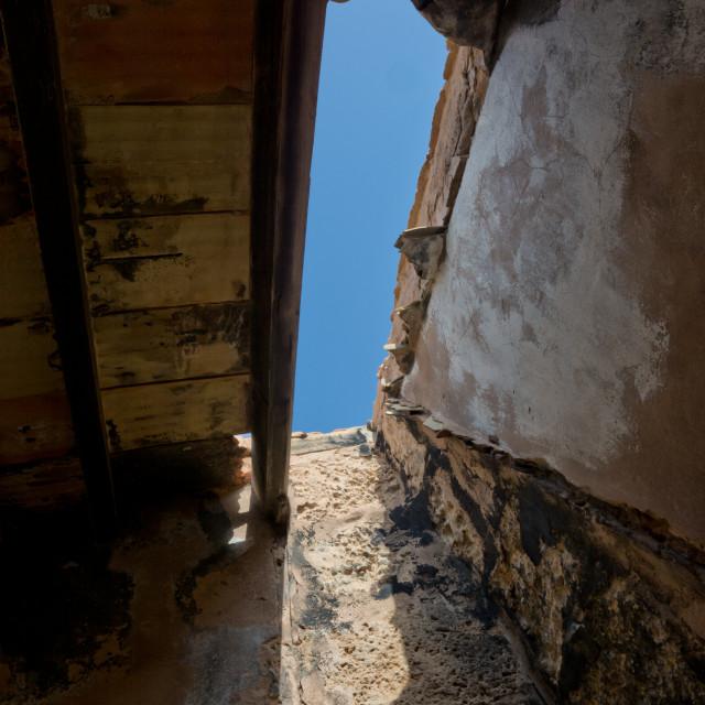 """Blue sky roof crack"" stock image"