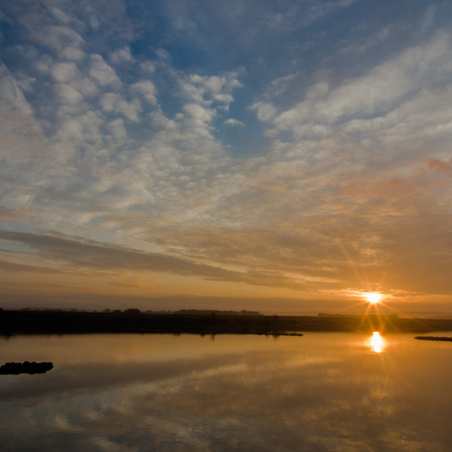 """Sunrise at Snettisham"" stock image"