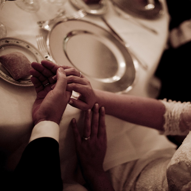 """Bride and groom holding hand in wedding reception marriage banquet angle"" stock image"