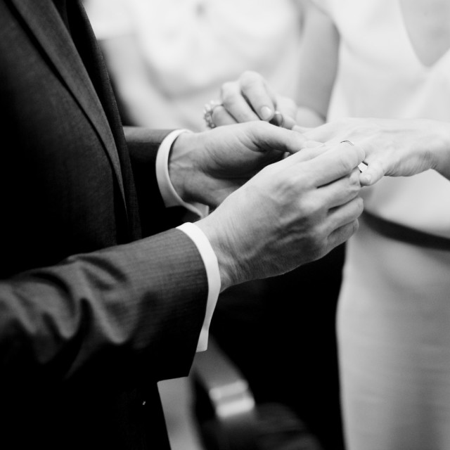"""Bride and groom exchanging rings in church wedding marriage ceremony"" stock image"