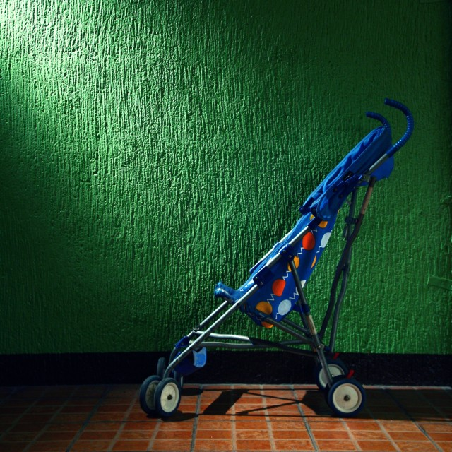 """child stroller in a garage"" stock image"