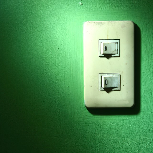 """light switch on a green wall"" stock image"