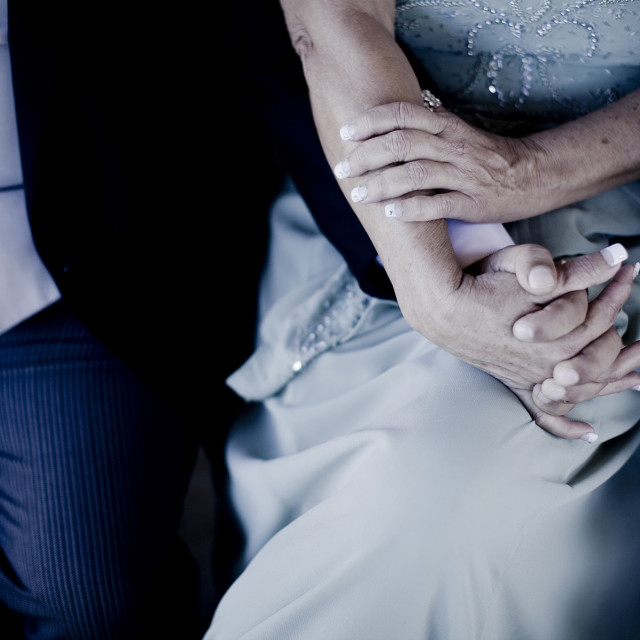 """""""Bride and groom holding hands in wedding marriage ceremony"""" stock image"""
