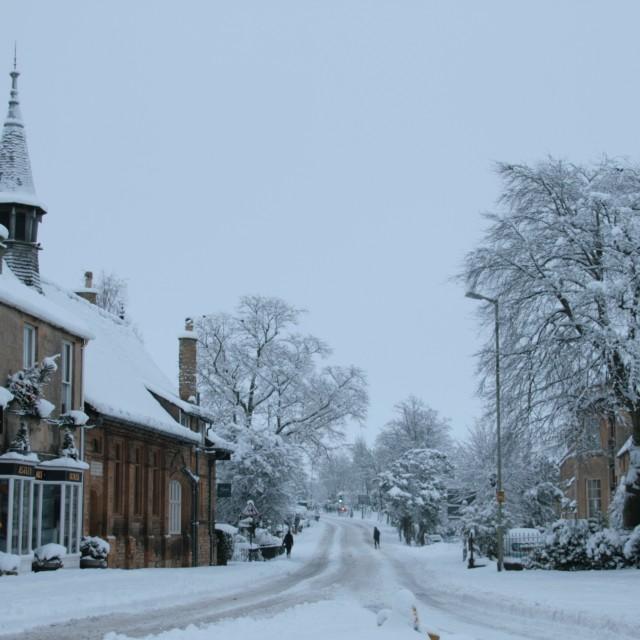 """Snowy Cotswold street scene"" stock image"