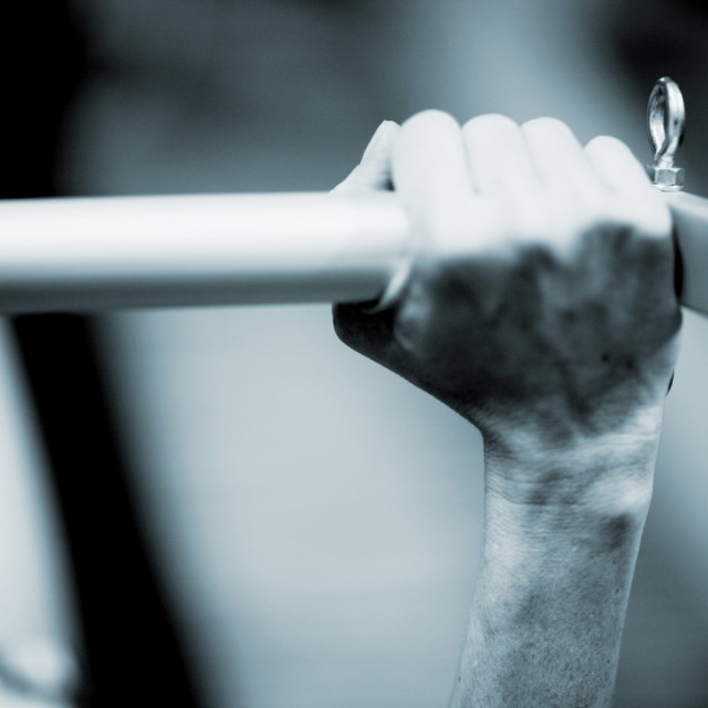 """Pilates exercise machine close-up hand on bar Photo Stock Image"" stock image"