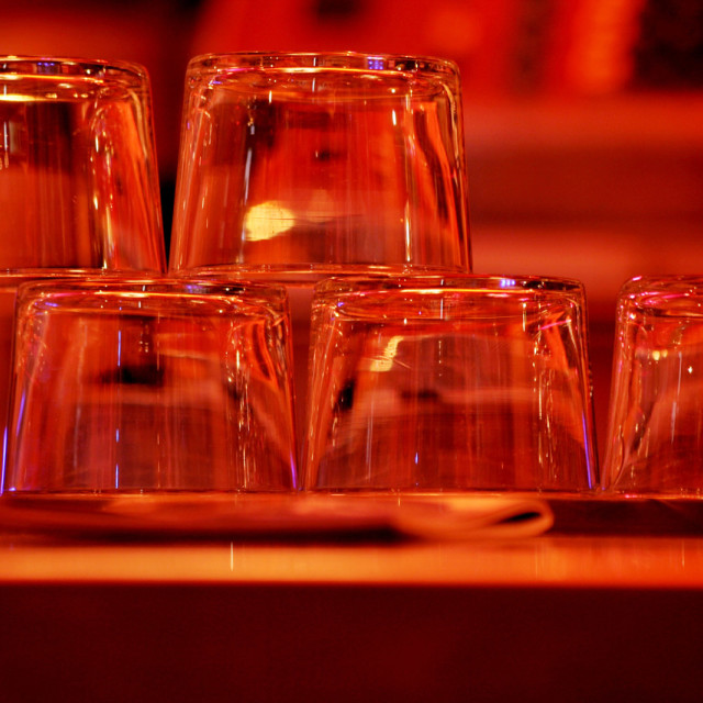 """Upturned wine glasses in restaurant bar close-up RF Stock Image"" stock image"