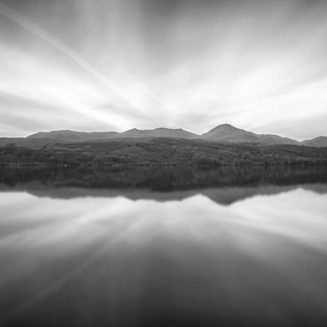 """Cumbrian Fell Reflections on Coniston Water in the Lake District."" stock image"