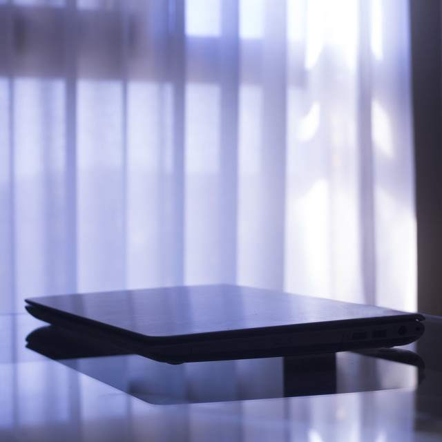 """Laptop pc computer on glass table in room Photo Stock Image"" stock image"