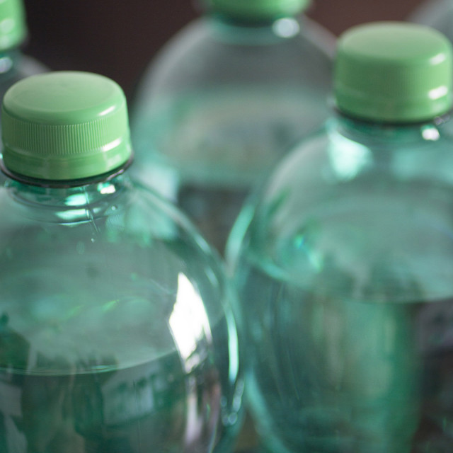 """Green bottles of sparkling mineral water close-up RF Stock Image"" stock image"