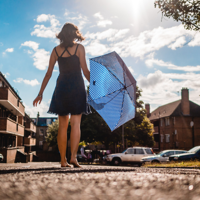 """Girl with Umbrella"" stock image"