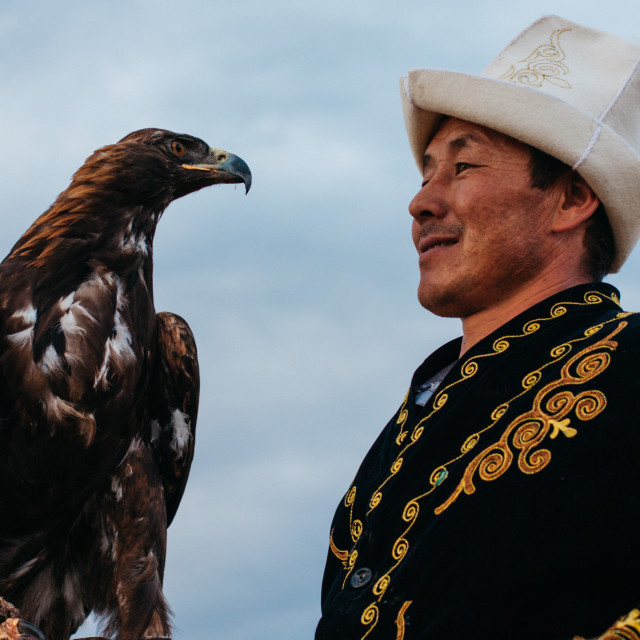 """Kyrgyz man and his eagle"" stock image"
