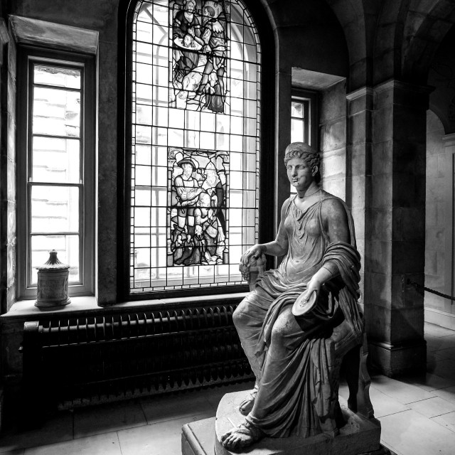 """Statue & Stained Glass in Stately Home UK"" stock image"