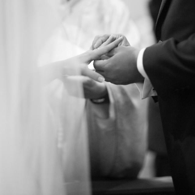 """Bride and bridegroom holding hands wedding marriage ceremony"" stock image"
