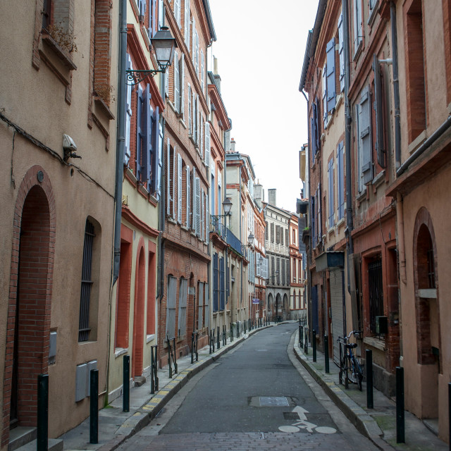 """Narrow Street in Toulouse, France"" stock image"