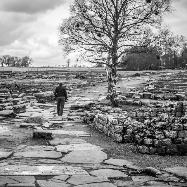 """Man Walking Old Roman Road B&W"" stock image"