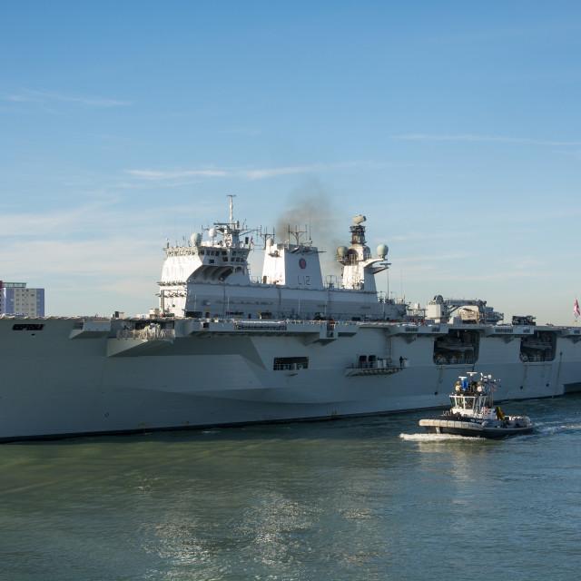 """HMS Ocean departing Portsmouth Harbour."" stock image"