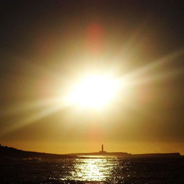 """Sun flare lighthouse"" stock image"