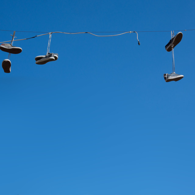 """Shoes hanging blue sky"" stock image"