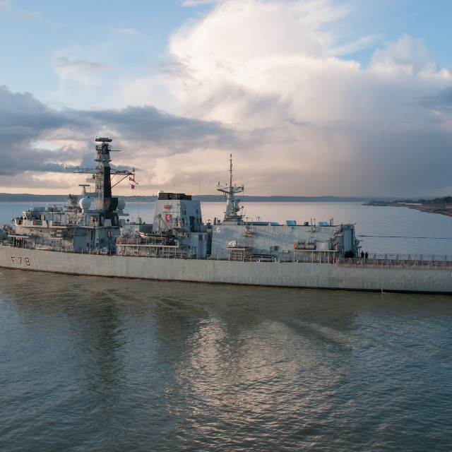 """Warship under a dramatic sky"" stock image"