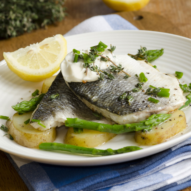 """Grilled seabass with new potatoes"" stock image"