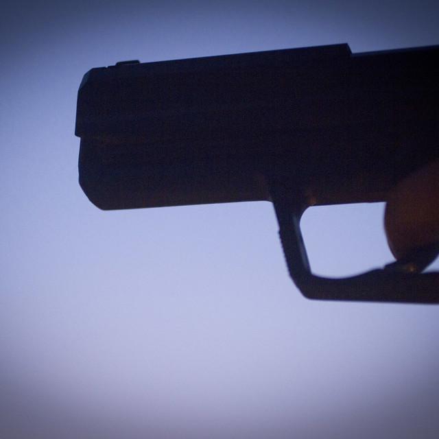 """Pistol revolver silhouette hand shooting gun"" stock image"