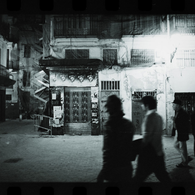 """""""Street photography photojournalism men in poor street at night"""" stock image"""