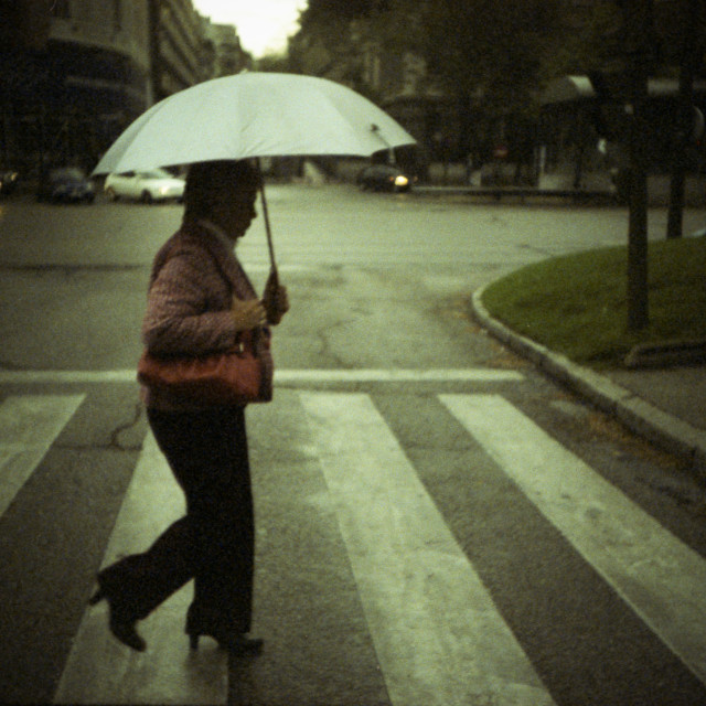 """Street photography photojournalism woman in rain with umbrella xpro lomo lca lomography"" stock image"