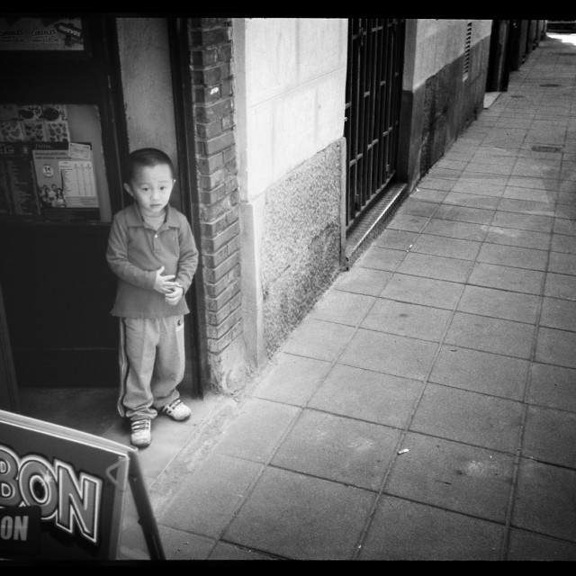 """""""Chinese Asian boy in street portrait photojournalism black and white"""" stock image"""