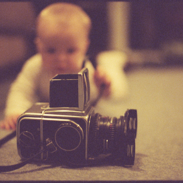 """Hasselblad 500cm and baby camera still life"" stock image"