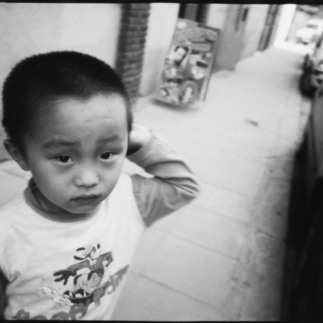 """Chinese Asian boy in street portrait photojournalism black and white"" stock image"