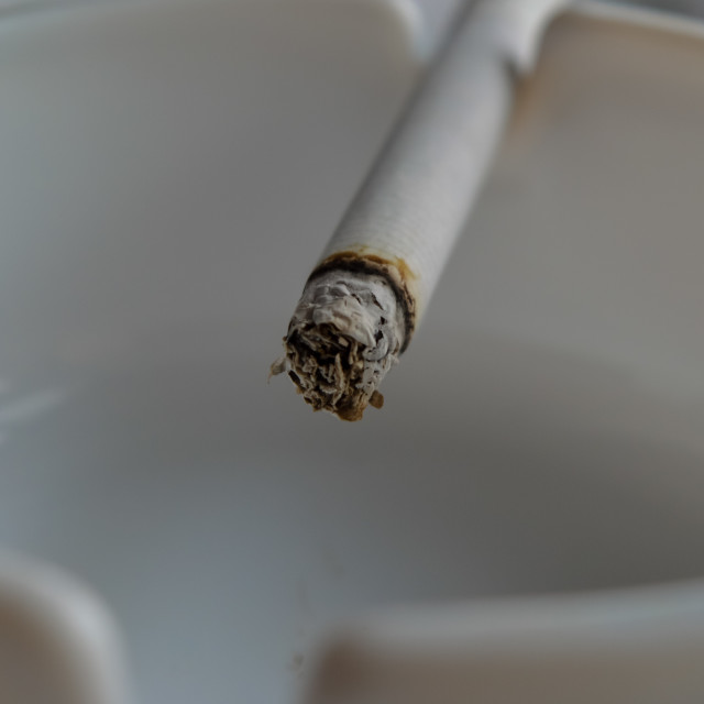 """""""Close up of a cigarette on an ashtray"""" stock image"""