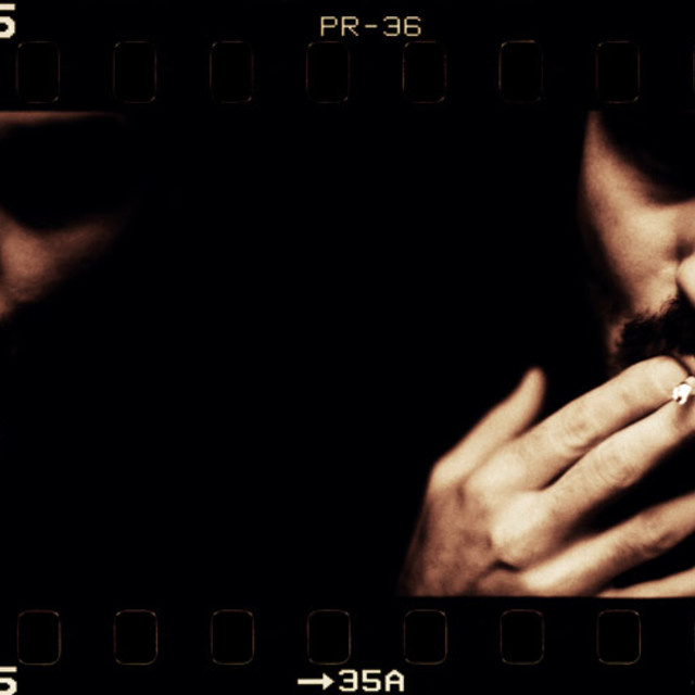 """Analogue film black and white gelatin portrait of gangster killer smoking in dark"" stock image"
