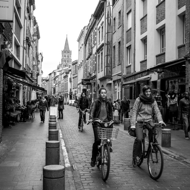 """Cyclists on Rue du Taur, Toulouse, France B&W"" stock image"