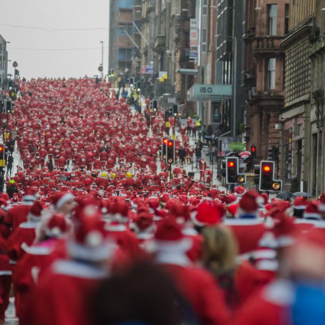 """A sea of Santas"" stock image"