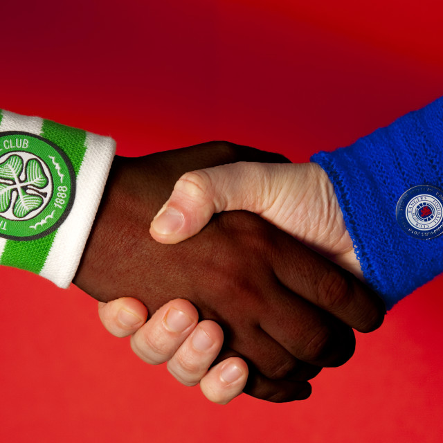 """Handshake across the divide"" stock image"
