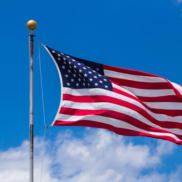 """American Flag Against Blue Sky"" stock image"