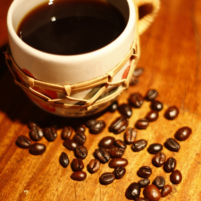"""""""cup of brewed coffee and coffee beans"""" stock image"""