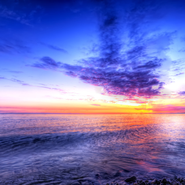 """""""Sunset at Dinas Dinlle"""" stock image"""