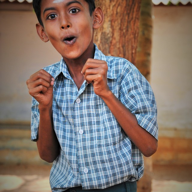 """Indian Schoolboy playing theatre"" stock image"