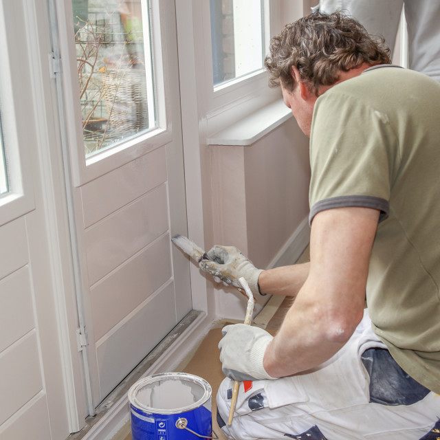 """""""Painting a door white"""" stock image"""