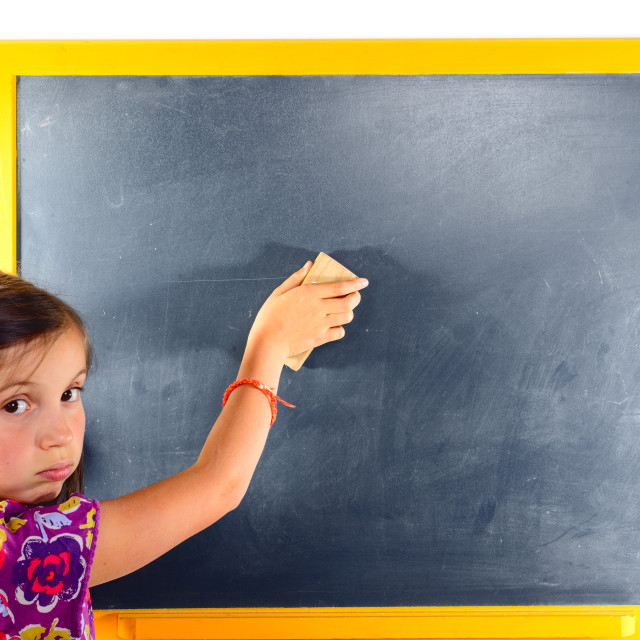 """a young schoolgirl erase the blackboard"" stock image"