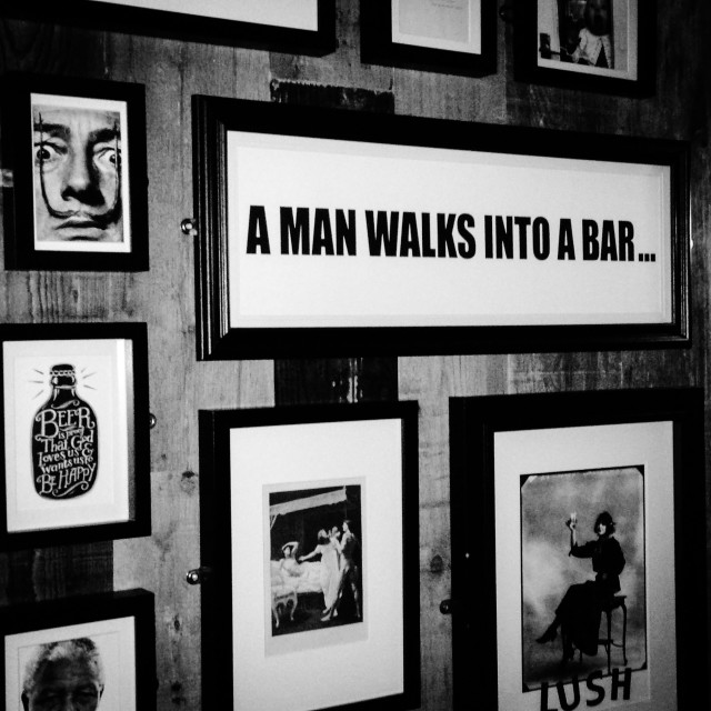 """A man walks into a bar..."" stock image"
