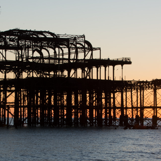 """The old pier at Brighton"" stock image"