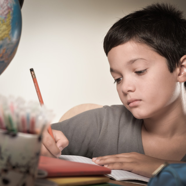 """Child writing at school"" stock image"