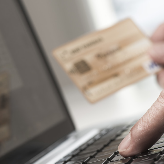"""Man using tablet pc and credit card indoor, Shopping online"" stock image"