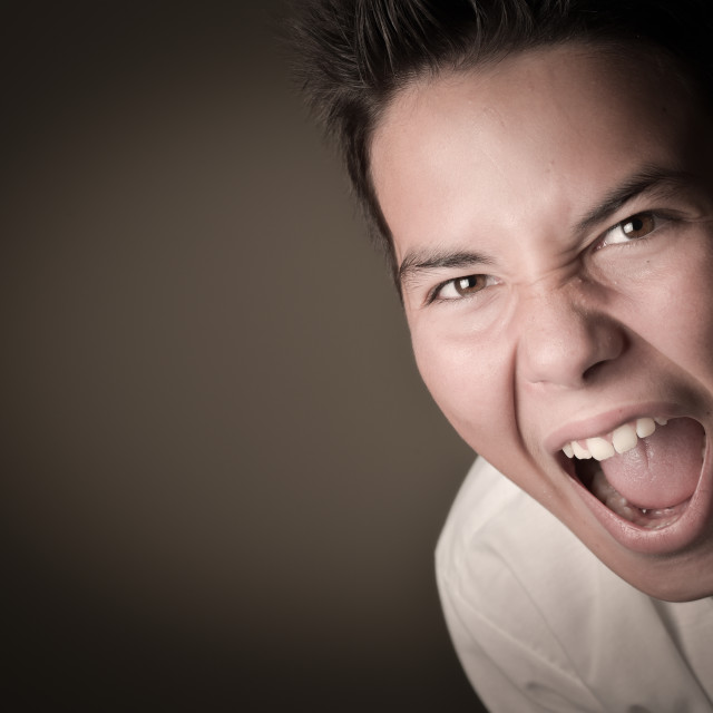 """""""Laughing boy cring,shouting, screaming, hysteria on a brown back"""" stock image"""