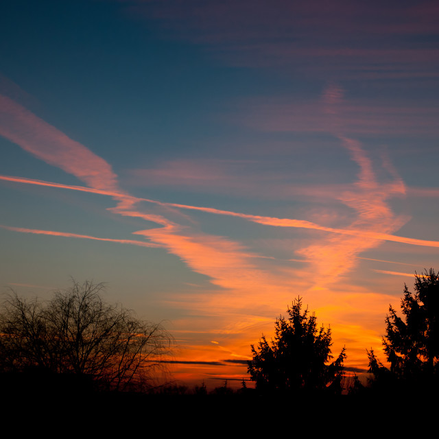 """""""Aeroplane contrails warm sunset"""" stock image"""