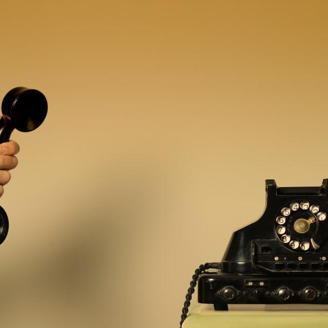 """Handing a phone - Rotary phone"" stock image"